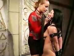 Classy mistress painfully punishing her slavegirl