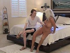 Sally D'Angelo finds a big dick in her bed