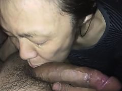 Asian MILF sucking a white rod