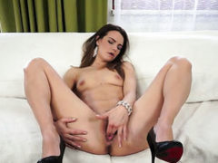 Brunette fills the hole between her legs with dildo