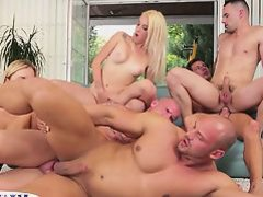 Assfucked hunks spraying cum in a bi orgy