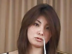Japanese babe in a gown shoves Kleenex tissues up her nose