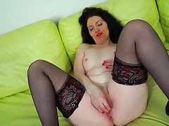 naughty cougar lydia masturbating on couch